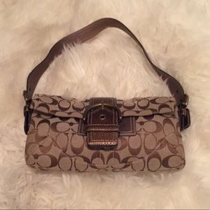 Classic Coach purse with snakeskin embellishment